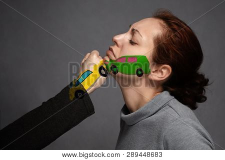 The Concept Of A Car Accident, Insurance.sudden Collision Of Cars . The Woman's Face And On The Fist