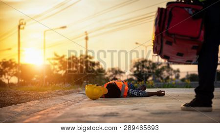 Accident At Work Of Construction Labor People, Basic First Aid And Cpr Training At Outdoor. Heat Str