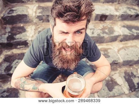 Guy Having Rest With Draught Beer. Hipster On Cheerful Face Drinking Beer Outdoor. Draught Beer Conc