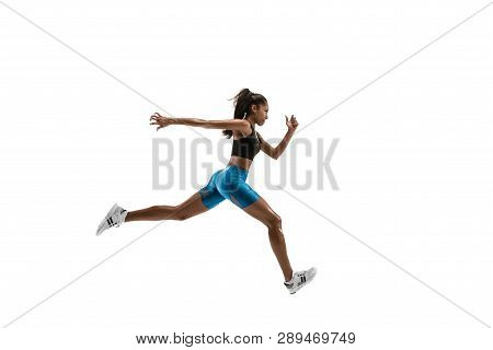 Young african woman running isolated on white studio background. One female runner or jogger. Silhouette of jogging athlete poster