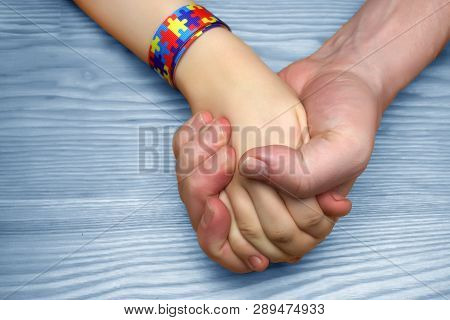 Autism Awareness Picture. Father Holding Hand His Autistic Child