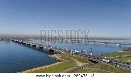 Aerial View Of Bridge Moerdijk Bruggen Over The River Hollandsch Diep In Holland. Those Bridges Conn