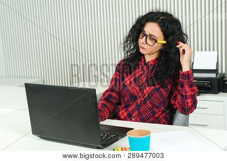Young Pretty Woman Working In Modern Office. Smart Girl Working With New Startup. Worker Woman In Gl
