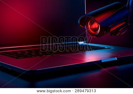 Computer Observed By Hostile Looking Camera As A Metaphor Of Stalking Or Malicious Software Observin