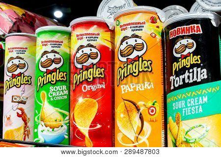 Minsk, Belarus, March 13, 2019: Variety Of Pringles Potato Chips Display In The Supermarket Shelve.