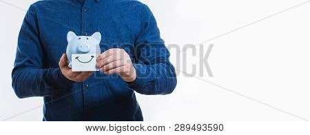 Close Up Of Male Body Holding A Piggy Bank With Smile Card Isolated On White With Copy Space. Concep