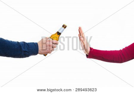 Close Up Of Male Hands Holding A Bottle Of Beer And Proposing It To A Woman Isolated Over White Back