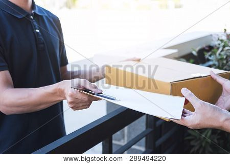 Delivery Mail Man Giving Parcel Box To Recipient And Signature Form, Young Owner Signing Receipt Of