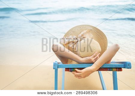 Summer Beach Vacation Concept, Asia Woman With Hat Relaxing And Arm Up On Chair Beach At Koh Mak, Tr