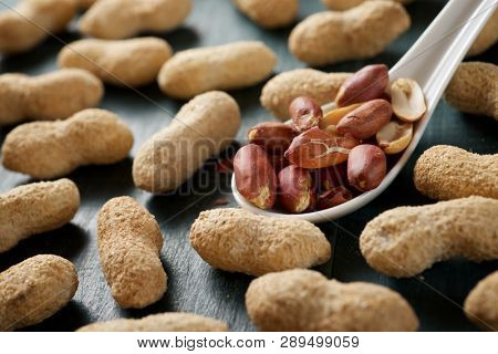 Peanuts with shell on a table.