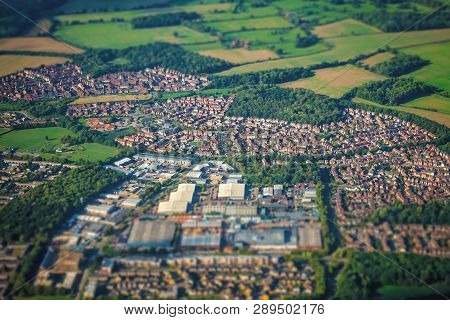 Aerial Shot Of The Small Town And Rural Landscape Seen From The Plane Window, Uk