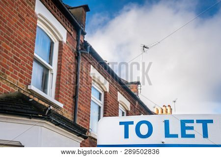 To Let Sign In Front Of A Real Estate Victorian Property In A London Suburb