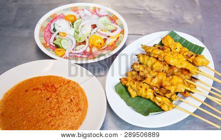 Appetizer Dish Of Traditional Thai Street Food Recipe, Pork Satay Grilled Pork Stick Putting On Bana