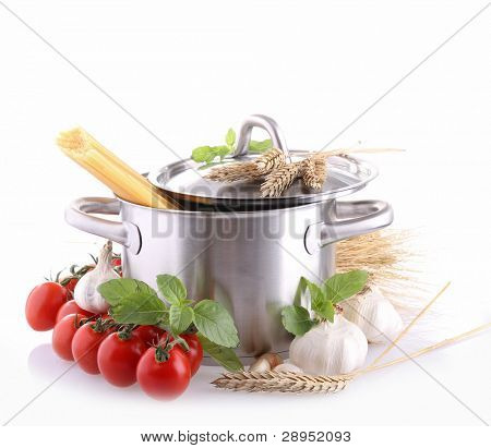 isolated pan with spaghetti and ingredient tomato sauce