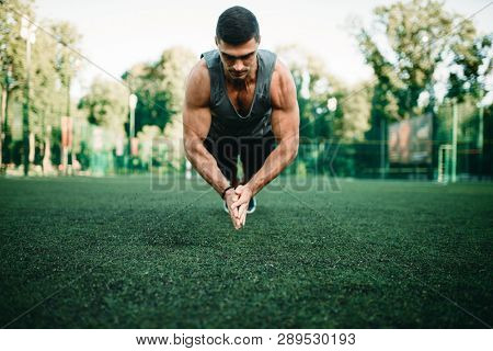 Athlete on training, push-up exercise in action