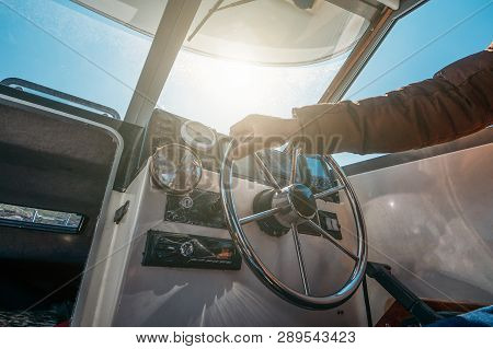 Boat Or Yacht Captain Hand On Boat Steering Wheel And Sea Navigation System, Close Up