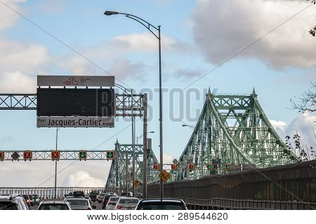 Montreal, Canada - November 8, 2018: Cars & Truck Traffic On The Highway Of Jacques Cartier Bridge W