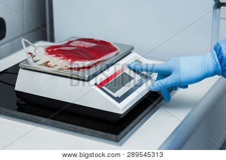 Weigh The Cleaned Blood Before The Box Gets To The Donor For Blood Transfusion. Evaluation Of Blood