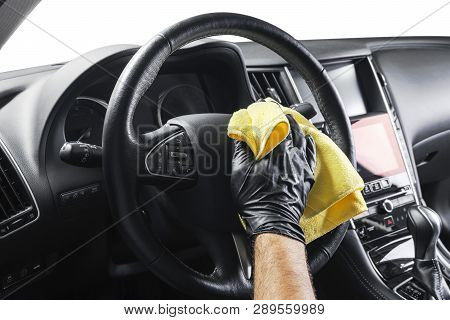 A Man Cleaning Car With Yellow Microfiber Cloth. Car Detailing Or Valeting Concept. Selective Focus.