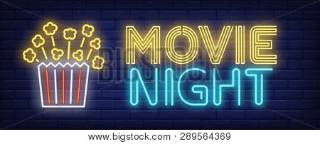 Movie Night Neon Text With Popcorn Paper Box. Cinema And Entertainment Concept, Advertisement Design