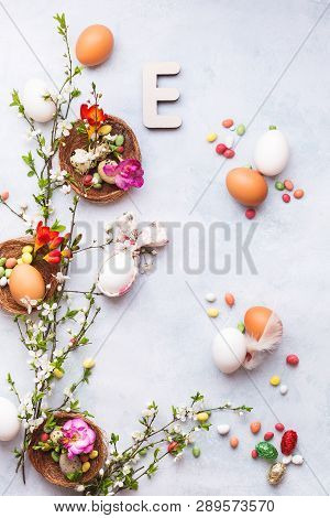 Easter Background With Various Eggs, Bunny Ears Napkin, Spring Blossom Branch,  Candies And Easter L