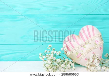 St. Valentine Day Background. Decorative Heart And White Flowers On White  Background Against Turquo