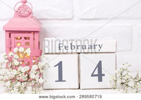 Calendar,  White Flowers, Pink Candleholder With Fairy Lights  On White  Background. Selective Focus