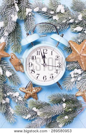 Blue Alarm Clock, Branches Fir Tree, Box With Present And Golden Stars On  Blue Textured  Background