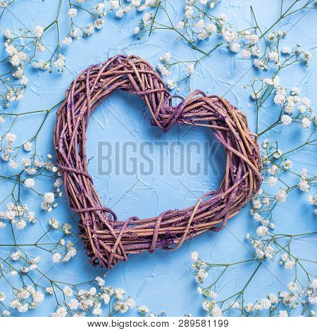 Big Decorative Heart And Pattern From Fresh White Gypsofila  Flowers On Blue Textured Background. To