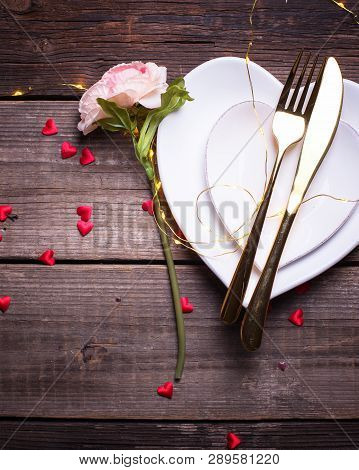 St. Valentine Day Table Setting.white Plates In Form Of Heart, Cutlery, Red  Decorative Heart, Flowe