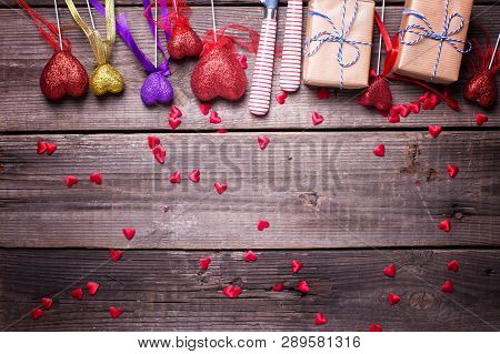 Border From Red, Violet And Gold Decorative Hearts, Boxes With Presents, Cultery On Vintage Wooden B