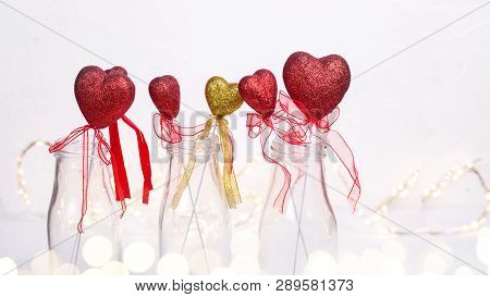 St. Valentine Day Background. Border From Colorful  Red  And Golden Hearts  In Bottles And Fairy Lig