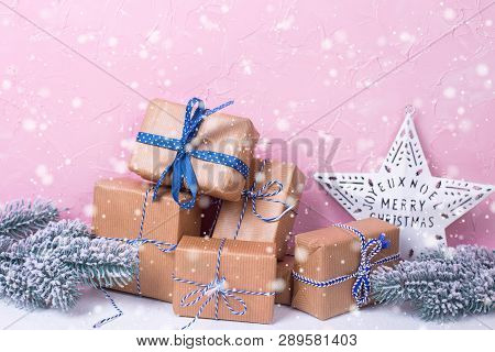 Wrapped Boxes With Presents, Fir Tree Branches  And Christmas Star On White Textured Background Agai