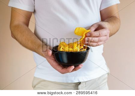 Processed Food, Unhealthy Diet, Imbalanced Ration. Overweight Man Eating Salted Fattening Potato Chi
