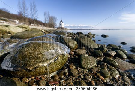 Icing On Stone At Pebble Beach. Lake Liptovska Mara, Slovakia