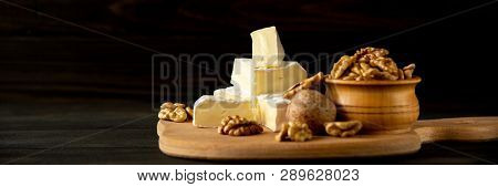 Cheese Camembert Or Brie With Walnut Kernels