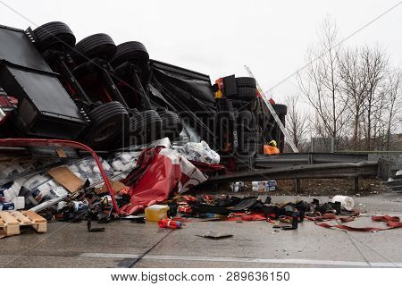 Enns, Upper Austria, Austria - March 15 2019: Large Truck Flipped Over In A Heavy Traffic Accident O