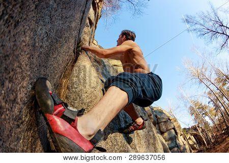 Rrock Shoe Close-up Of A Rock Climber Climbs A Boulder Over A Rock Without Insurance