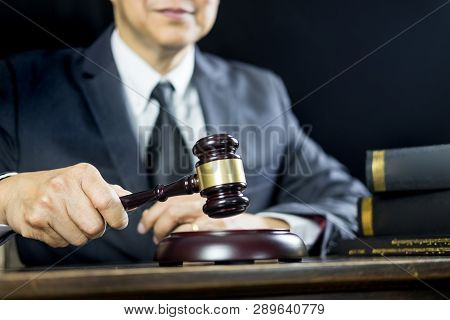 Justice And Law Concept.male Judge In A Courtroom Working On Wood Table With Documents., Attorney Co