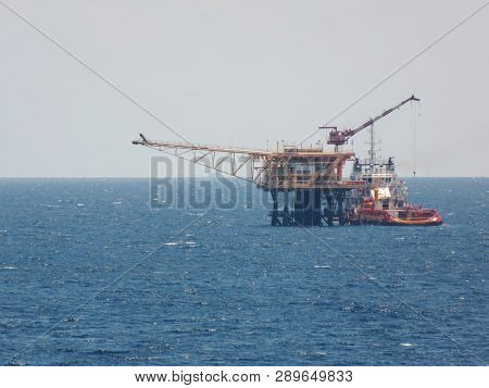 Supply Boat Support Oil And Gas Industry.supply Boat Transfer Cargo To Oil And Gas Industry And Movi