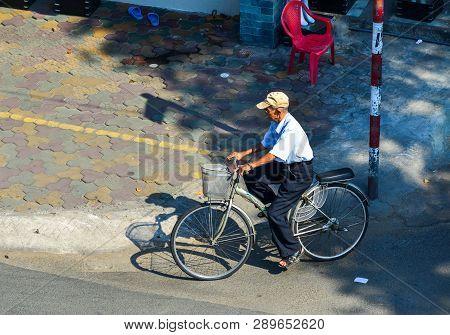 Saigon, Vietnam - Feb 1, 2019. An Old Man Biking On Street In Saigon, Vietnam. Saigon Is One Of The
