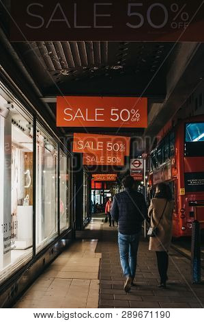 London, Uk - March 9, 2019: People Walking Under Sale Signs On House Of Fraser Oxford Street Store,