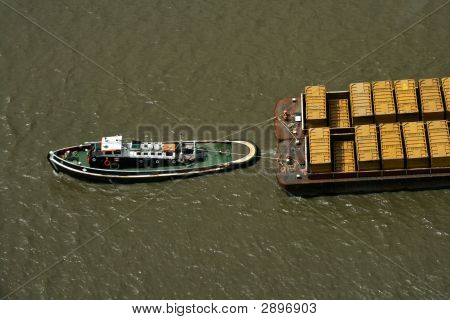 Tug Boat Pulling Refuse Containers On The Thames
