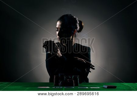 Silhouette Poker Girl With A Cigar