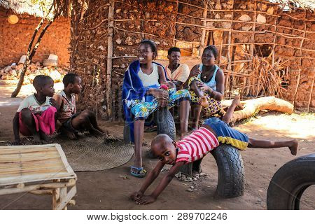 Malindi, Kenya - April 06, 2015: Local Women With Their Kids Sitting In Front Of Their Provisional H