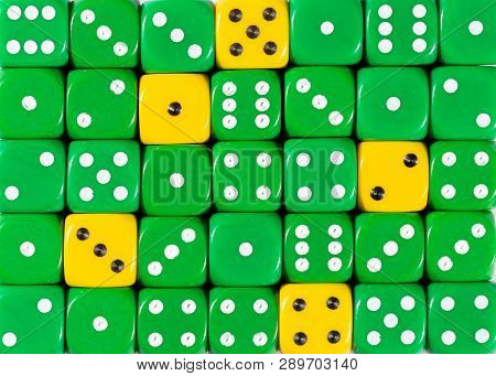 Pattern Background Of Random Ordered Green Dices With Five Yellow Cubes