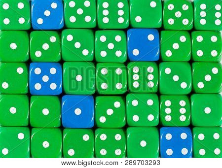 Pattern Background Of Random Ordered Green Dices With Five Blue Cubes