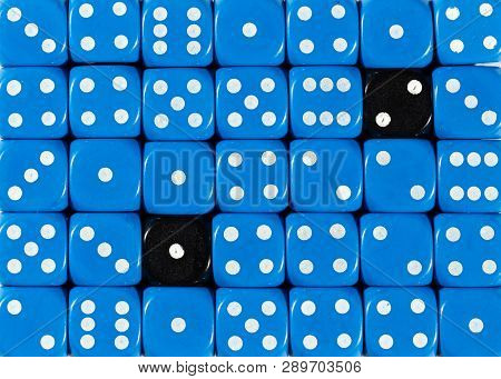 Pattern Background Of Random Ordered Blue Dices With Two Black Cubes