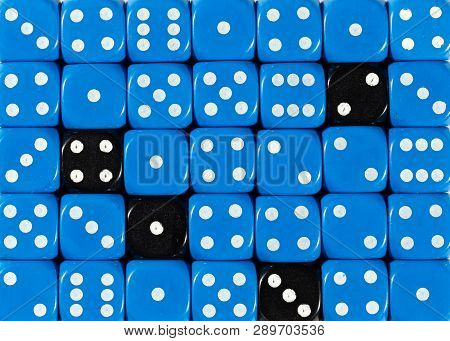 Pattern Background Of Random Ordered Blue Dices With Four Black Cubes