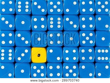 Pattern Background Of Random Ordered Blue Dices With One Yellow Cube